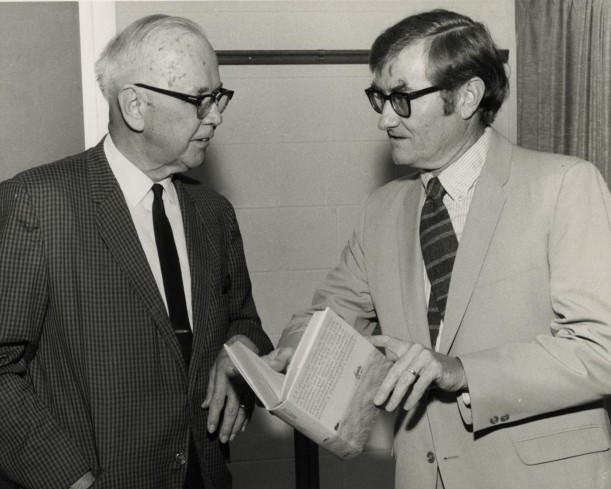 [Photograph of George Steinman and A. C. Greene, Jr. Talking]