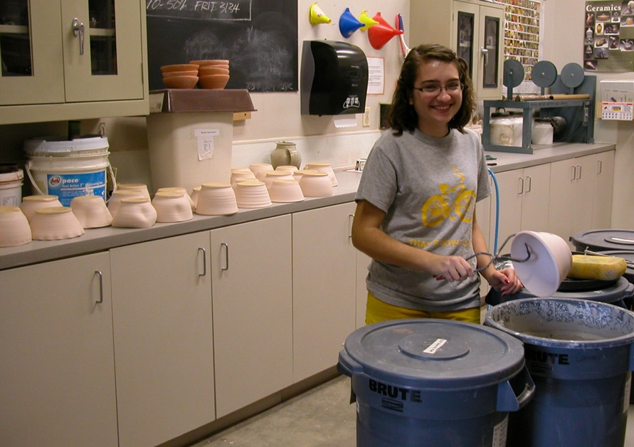 Kira McEntire '13 glazing all of her bowls