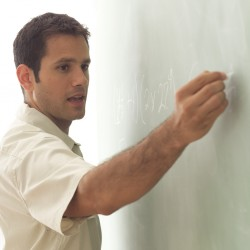 Math Teacher Writing on Chalk Board 2003