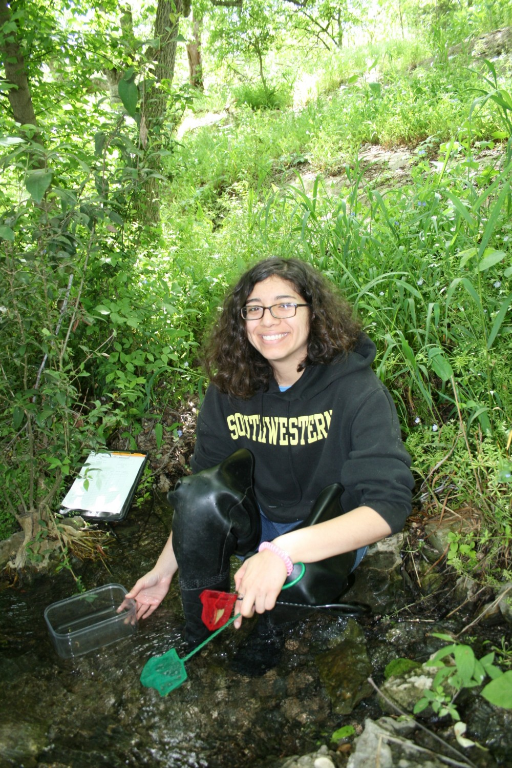Areli in the field doing her Capstone research on Georgetown Salamander.