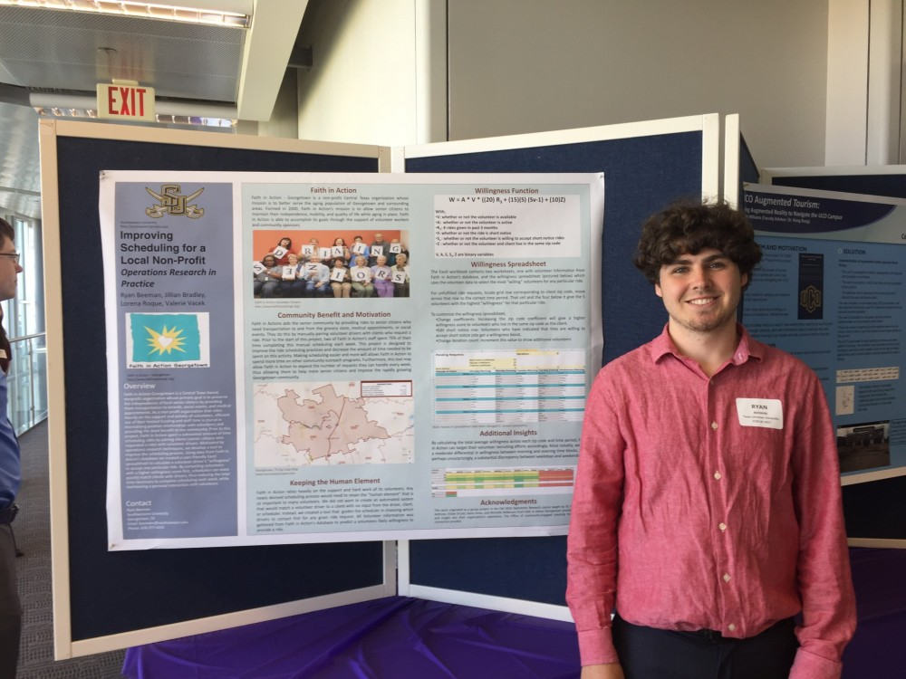 Student Ryan Beeman in front of the poster based off of work that started in his Operations Research class taught by Dr. B...