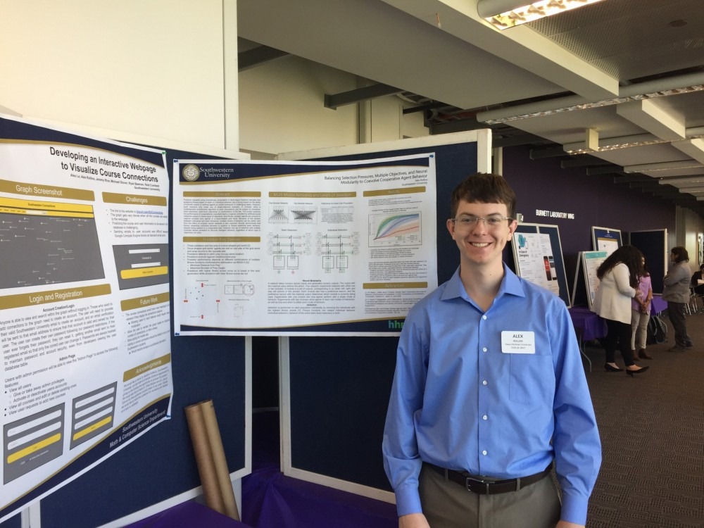 Student Alex Rollins in front of his poster describing research with Dr. Jacob Schrum that started during SCOPE