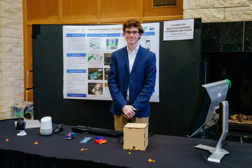 Computer Science major Cameron Henkel presents his automated medication dispenser