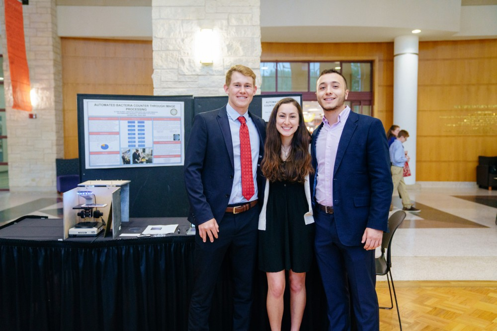 Computer Science and Math double-major Elyssa Sliheet joins students Alexis Dimanche and Sebastian Somolinos in presenting...