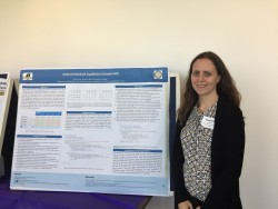 Dr. Barbara Anthony in front of the poster she worked on with student Austin Moniger