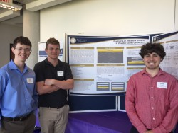 Students Alex Rollins, Michael Glover, and Ryan Beeman in front of their poster describing their Capstone project
