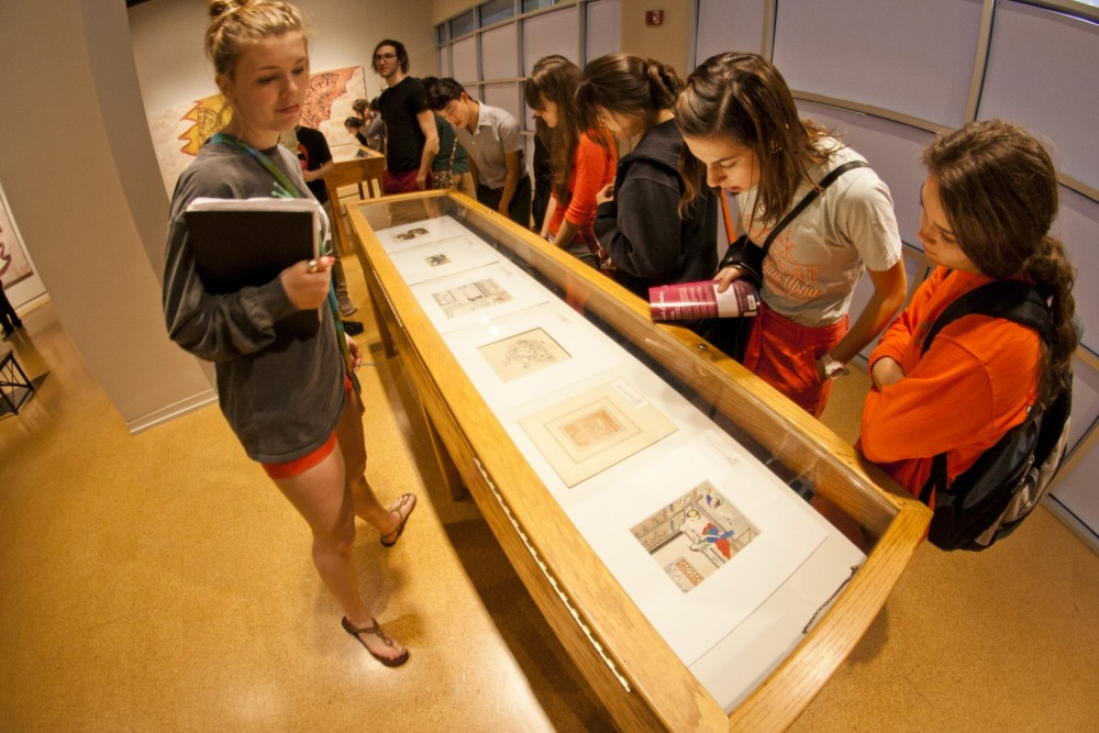 Students view art from the Kinsey Institute.