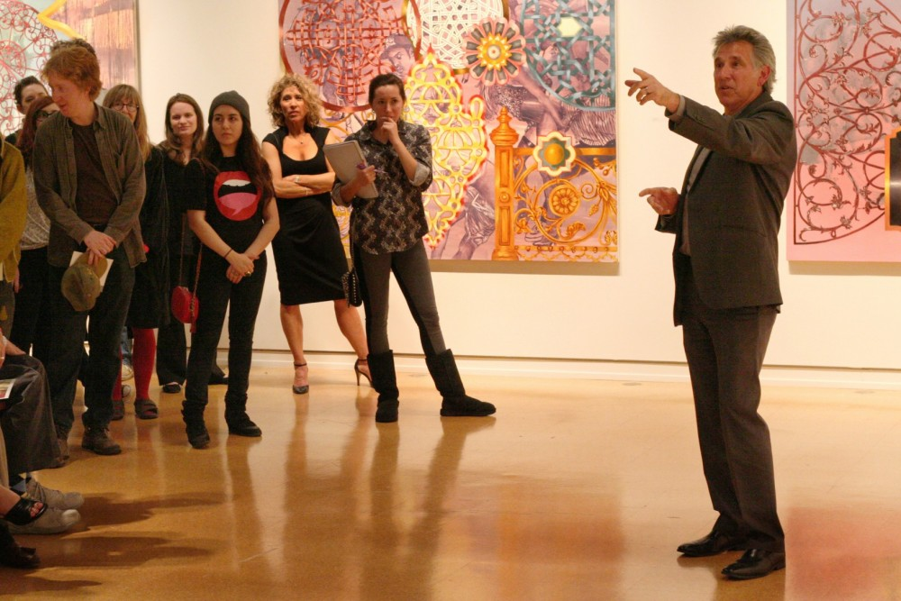 Michael Mogavero discusses his paintings with students and guests at the Brown Symposium.