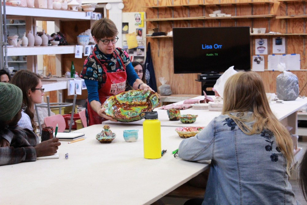 Lisa Orr discusses her earthenware style with students.