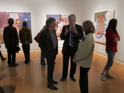 Michael Mogavero visits with President Jake Schrum and Victoria Star Varner, curator of the exhibition.