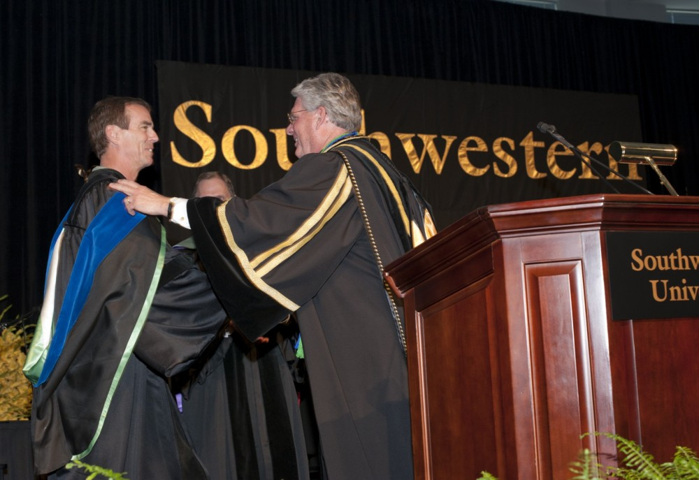 Kinesiology Professor Jimmy Smith receives the 2012 William Carrington Finch Award from President Jake B. Schrum. (Photo b...