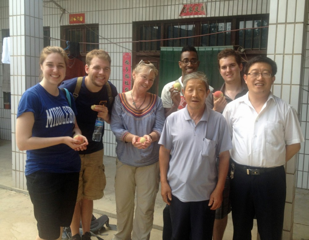 Clayton Tucker (back row, at right) and fellow participants in his NSF-funded program stand with a Chinese farmer and a lo...