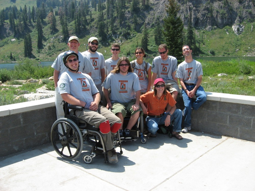 Kate Stephens (kneeling in the orange shirt), poses for a photo with members of one of the UCC's inclusive crews at Tony G...