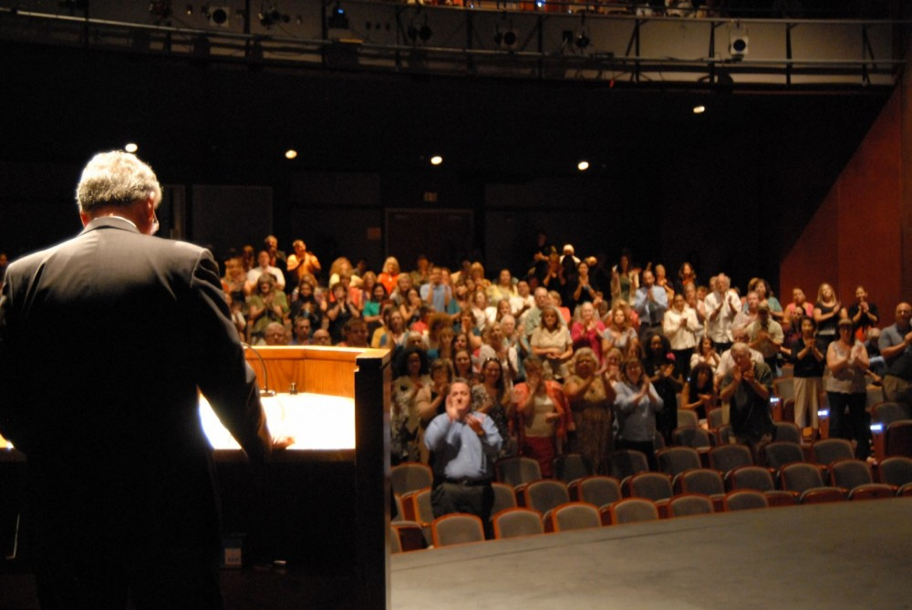 President Jake B. Schrum receives a standing ovation after announcing his retirement to faculty and staff members.