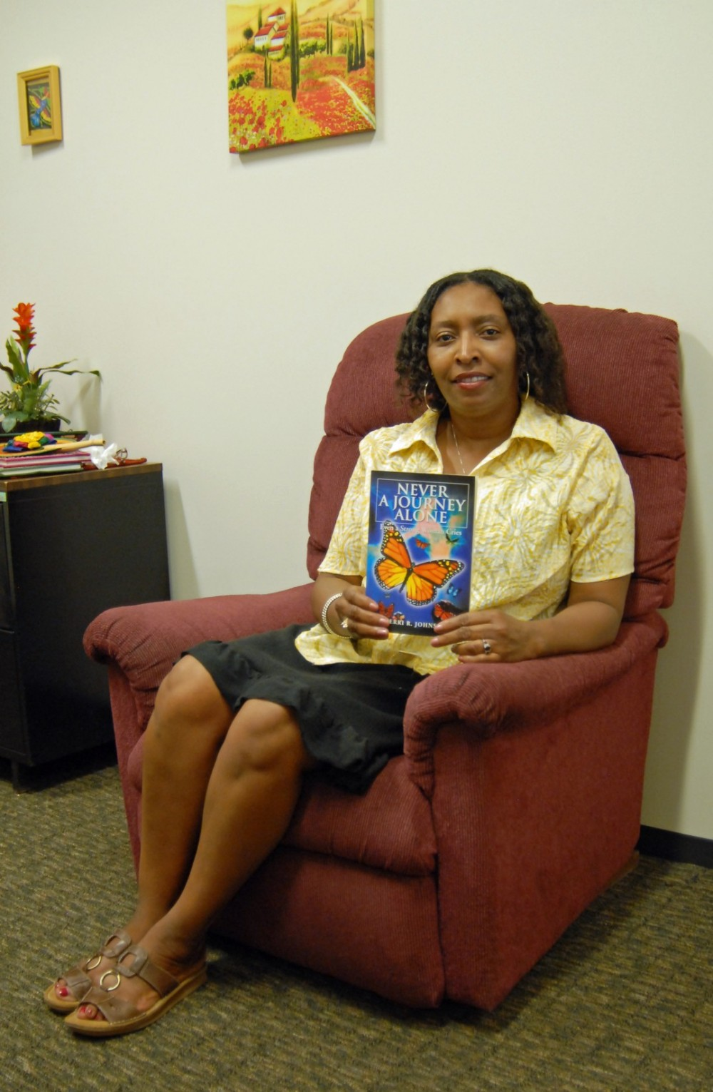 Terri Johnson, assistant dean for student multicultural affairs, displays a copy of the poetry book she recently published.