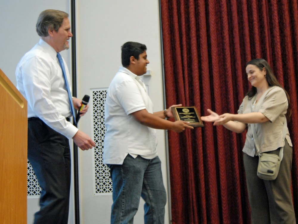 Arun Jacob presents the teaching award for  visiting and part-time faculty members to Patricia Sciaffini, part-time instru...