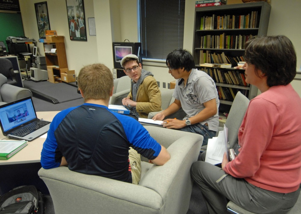 Alisa Gaunder, associate professor of political science, checks in with Zach Coats, Jesse Chiu and Danny Jozwiak during th...