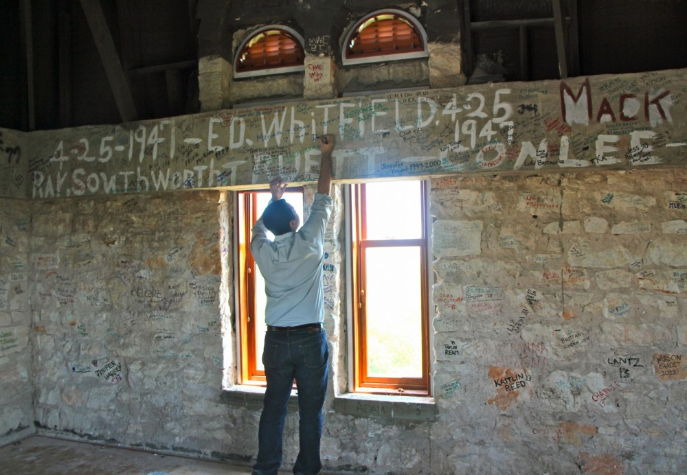Signing the Cullen Tower is a longstanding tradition for Southwestern students before they graduate. Senior David Briner i...