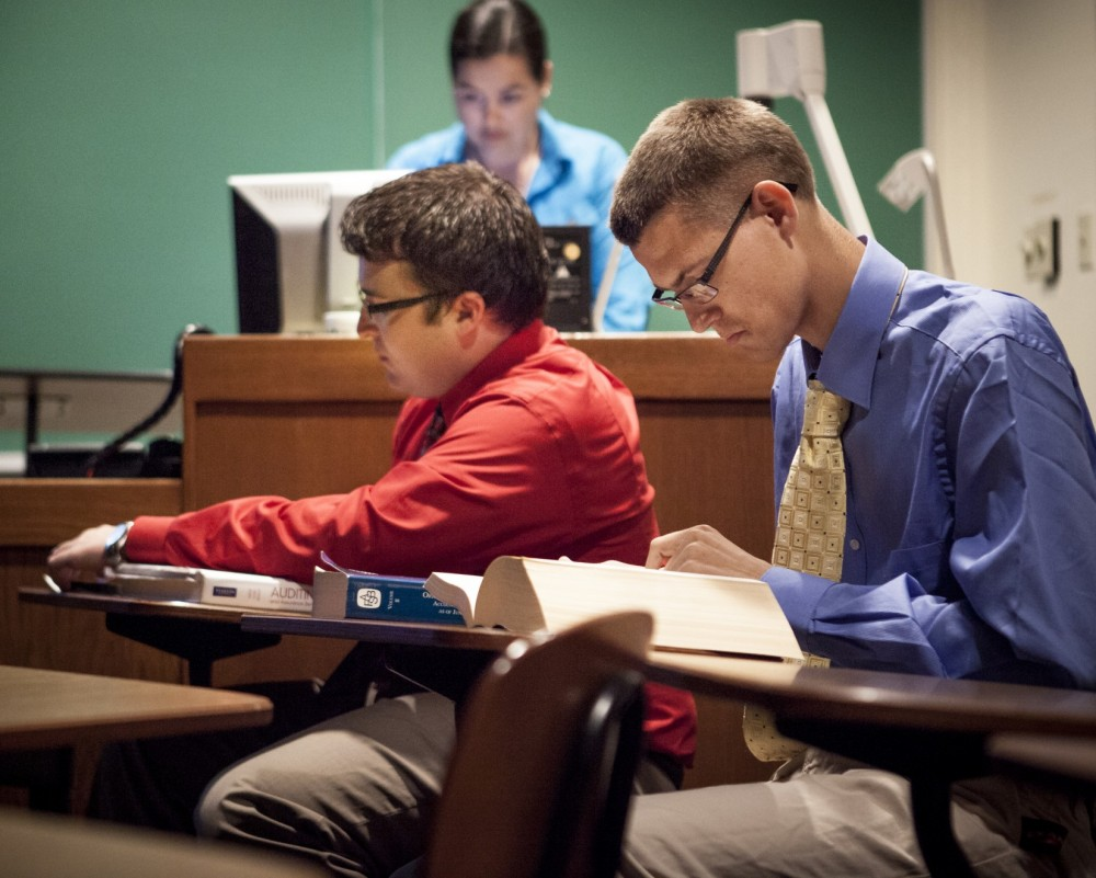 Philip Davis studies accounting rules during his capstone class. (Photo by Lance Holt).