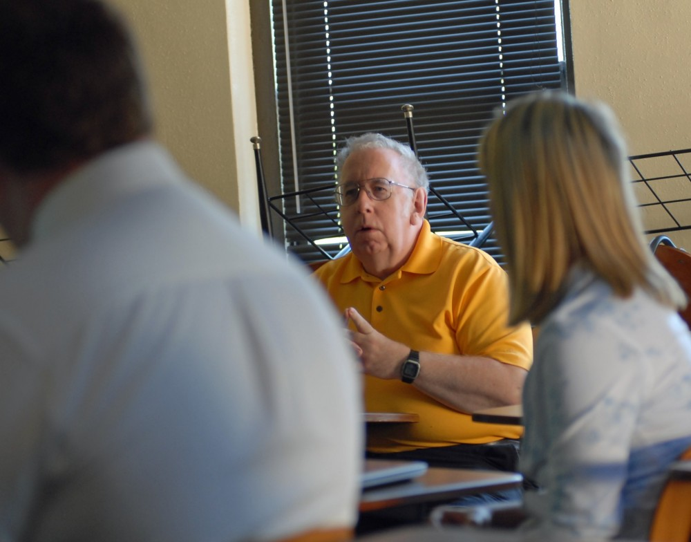 Professor John Delaney leads a discussion with students in his new Fraud Examination class.