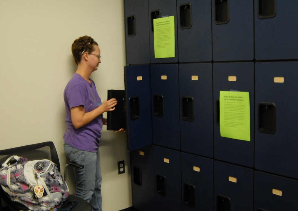 Shelby Alvarez makes use of the lockers in the new commuter student lounge.