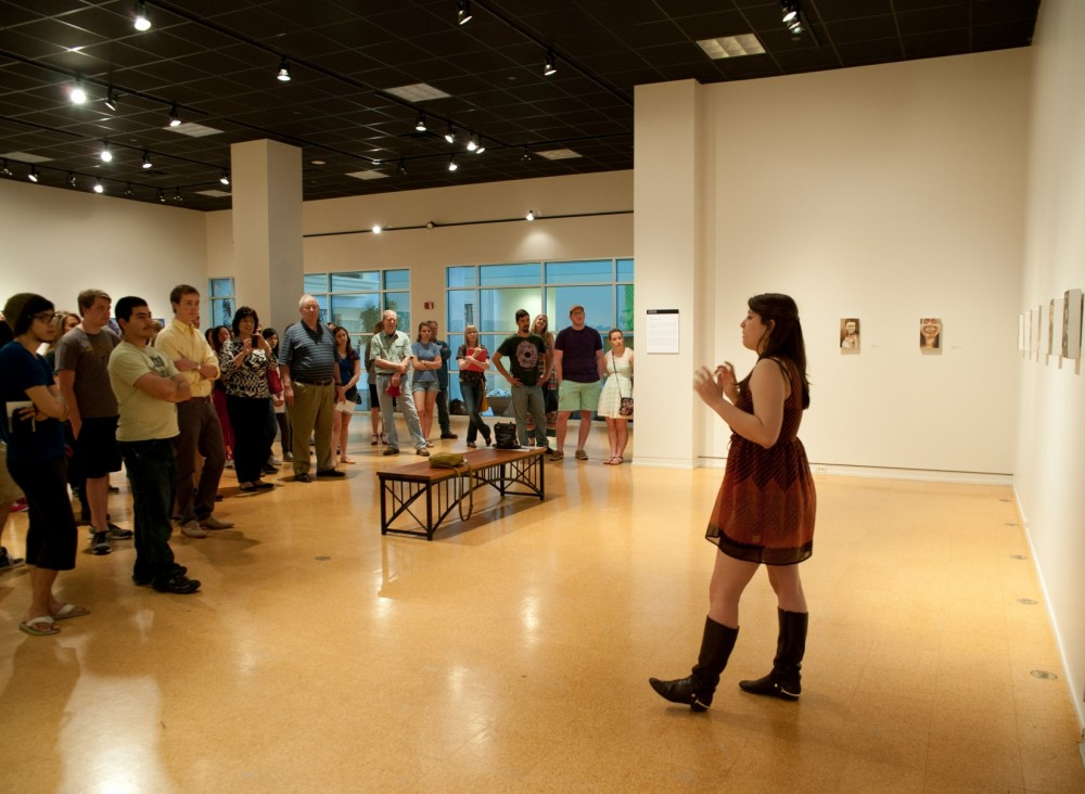 "Sarah Kinney discusses the paintings in her senior art exhibit titled ""Selfies."""