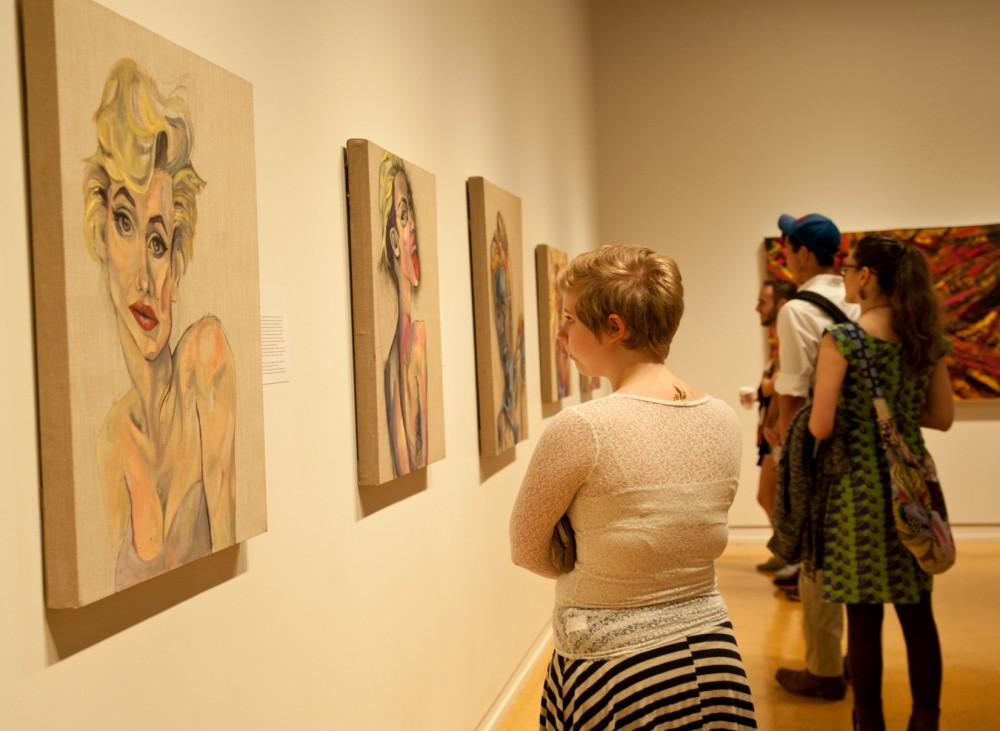 Erika Clugston's paintings were on display at the 2014 Research and Creative Works Symposium.