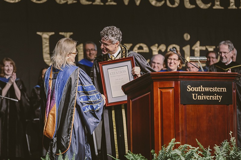 President Edward Burger presents the 2014 William Carrington Finch Award to Erika Berroth. (Photo by Carlos Barron)