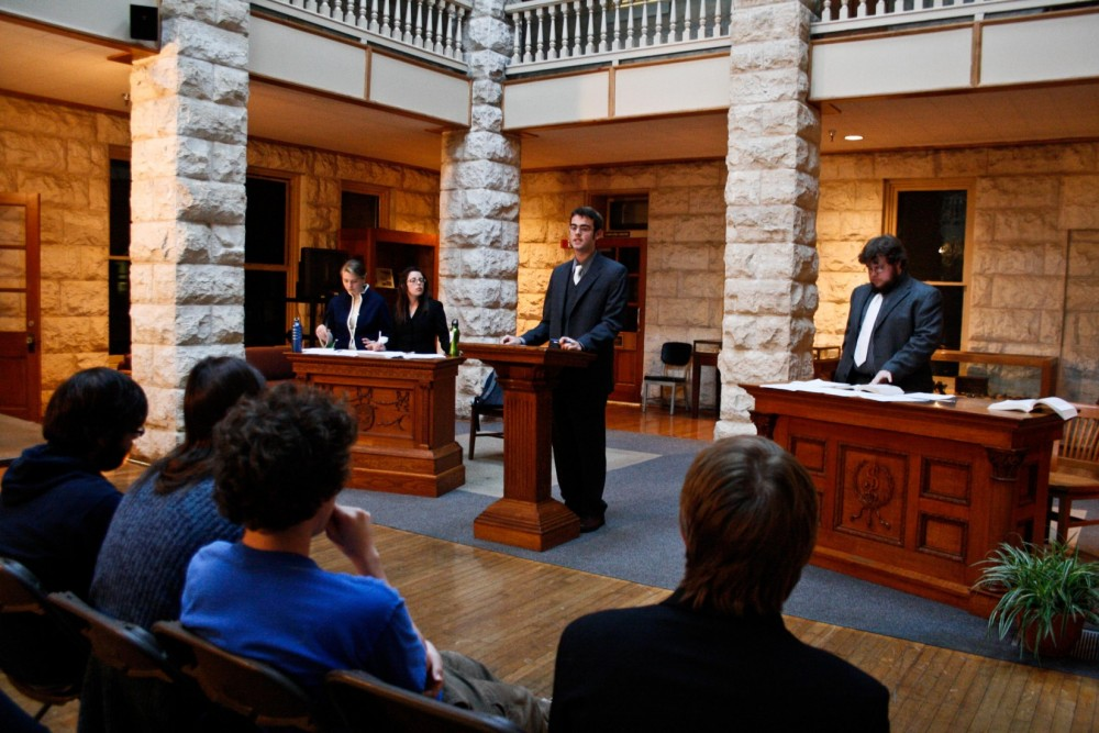 Students participate in the opening rounds of the debate competition.