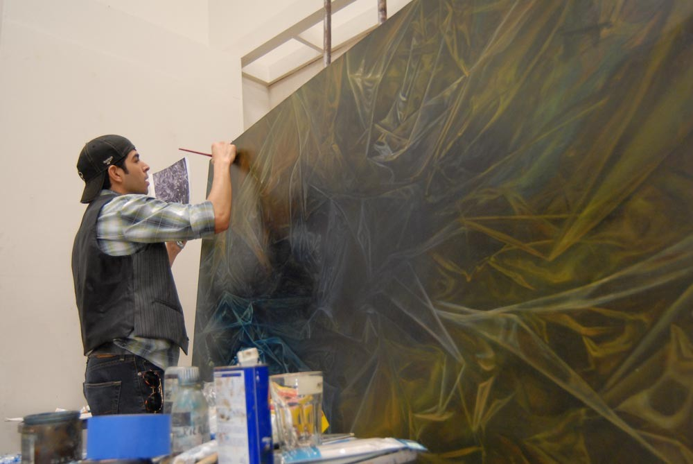 "Ricardo Levario puts the final touches on his painting, ""Asphyxia,"" in Southwestern's painting studio."