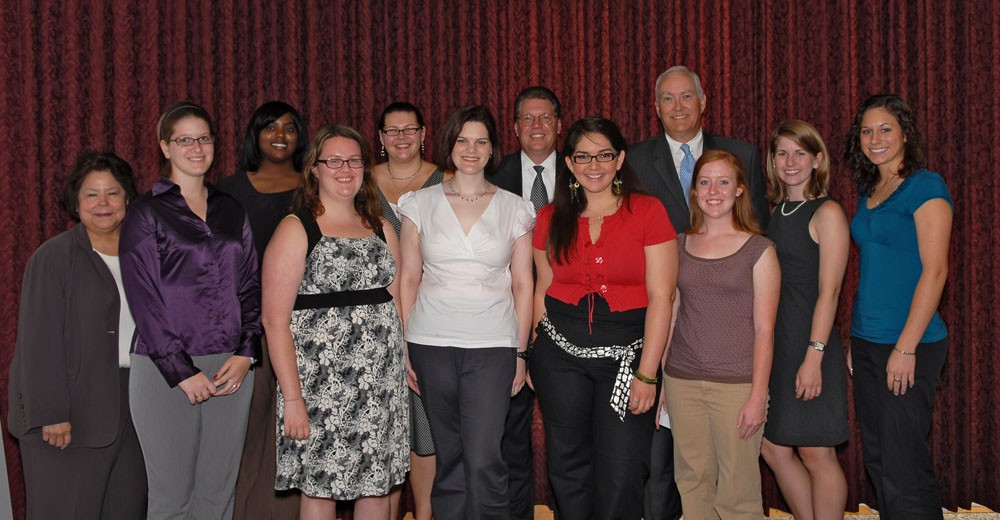 Participants in the 2009 summer domestic violence internship program stand with representatives from Verizon, which funded...