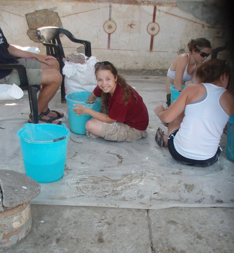 Georgia LoSchiavo mixes plaster at the site of the Villa Arianna in Stabiae.