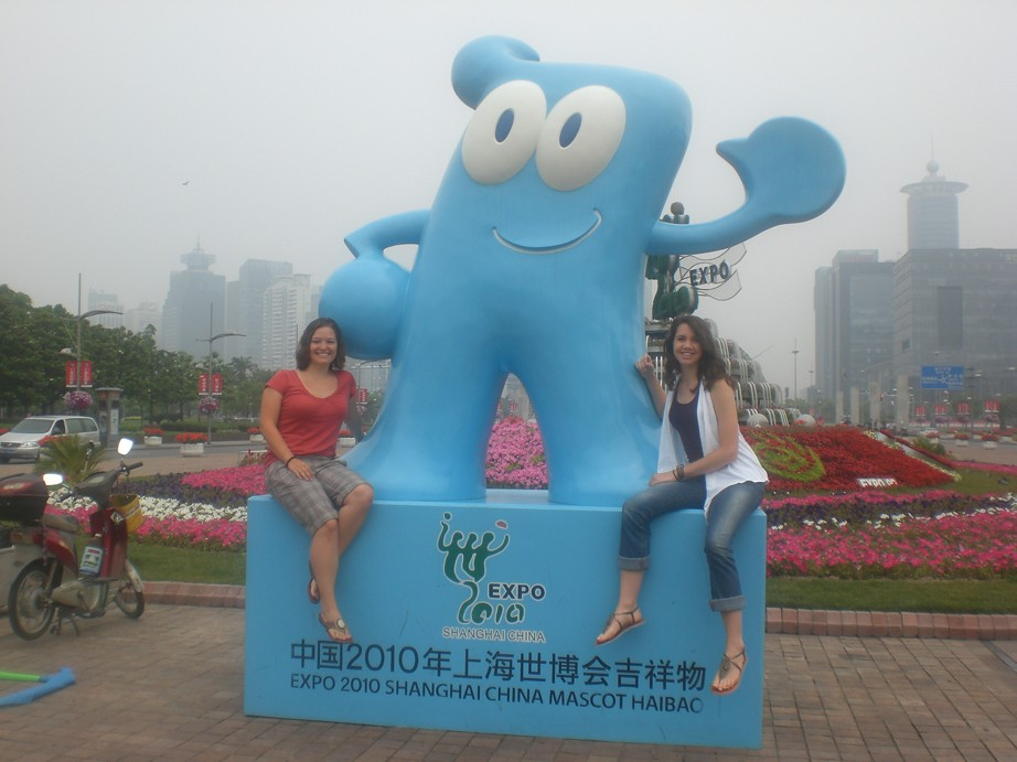 Andrea Loer and Anne Fenley pose with Haibao, the World Expo 2010 mascot.
