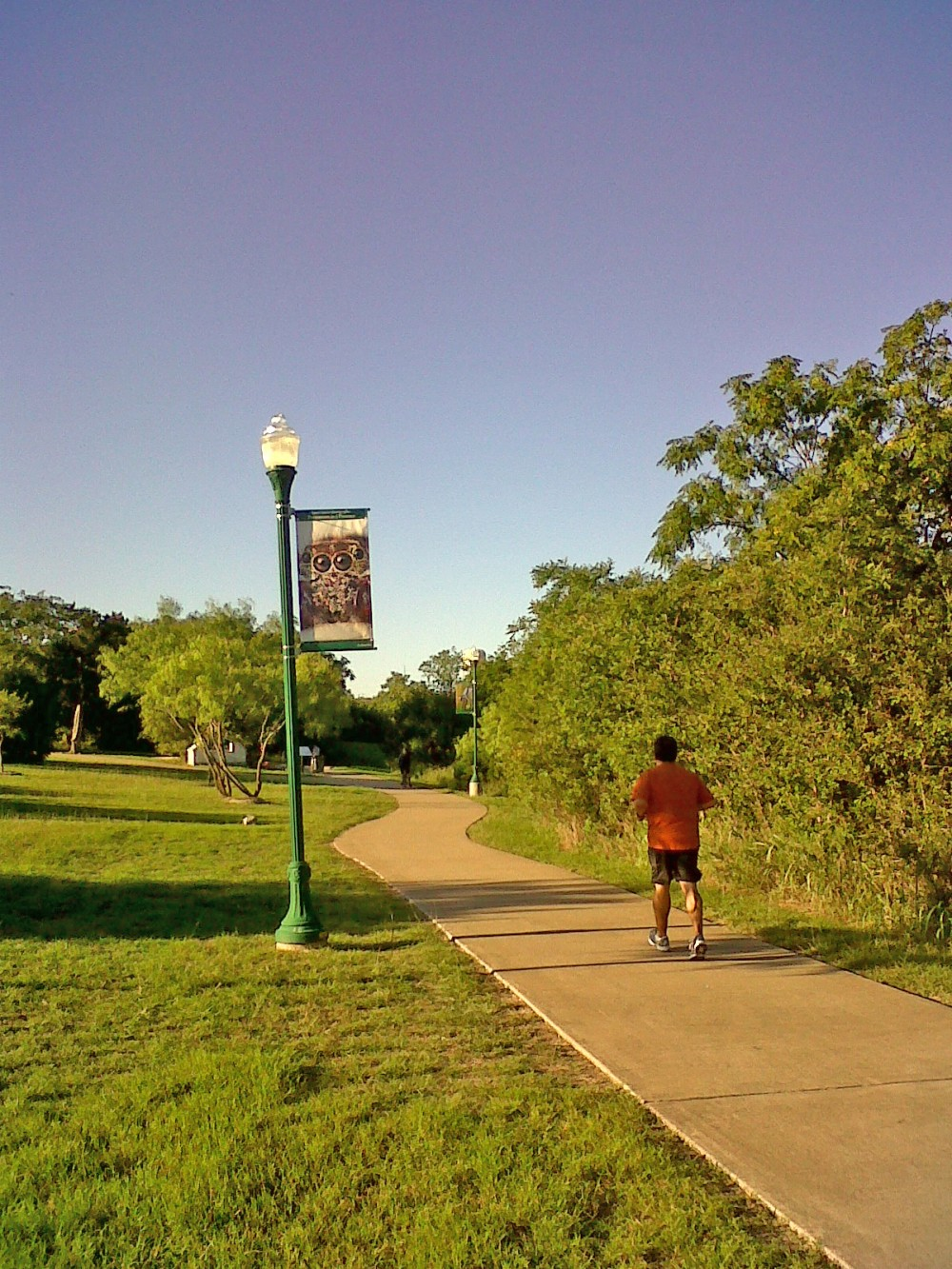 Banners featuring photography by SU grad Carlos Barron line the hike and bike trail near Rivery Park.