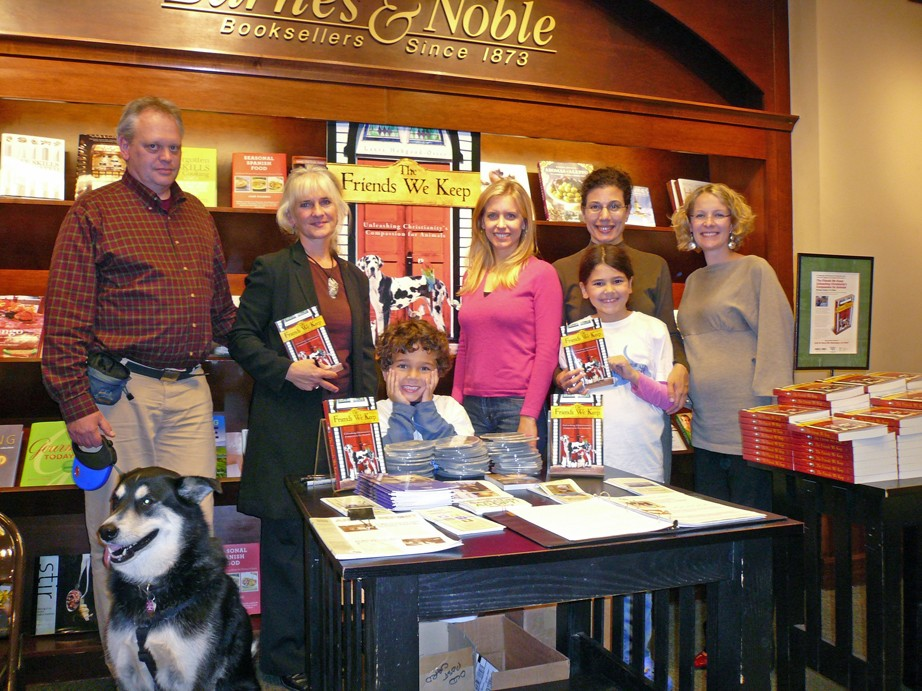 Laura Hobgood-Oster signs copies of her new book at a bookstore in the Washington, D.C., area