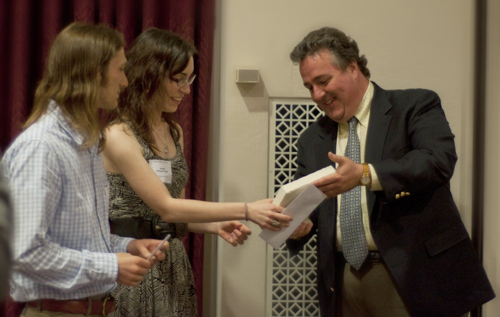 Natalie Phillips-Perkoff and Will Hardy receive the 2011 Walt Potter Prize from Joey King, who endowed the King Creativity...