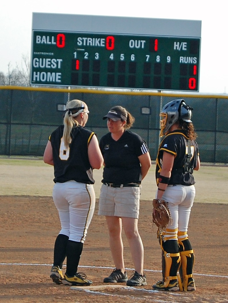 Softball coach Angela Froboese consults with pitcher Lyndsy Maus and catcher Abigail O'Connor during a 2011 game. Froboese...
