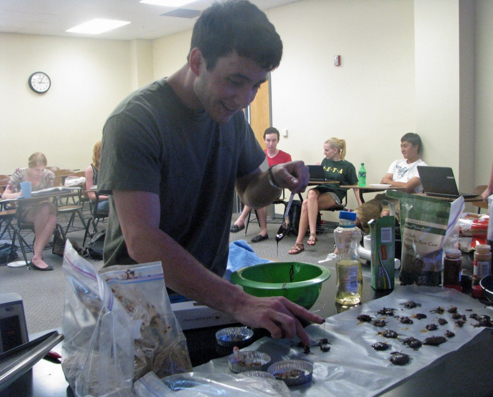 Steven Rubin makes chocolate dipped crickets for students in the Invertebrate Ecology class.