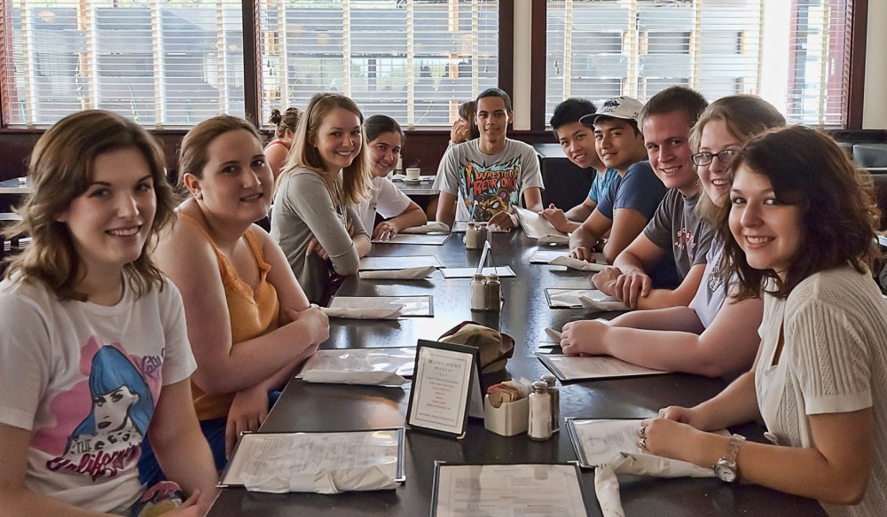 First-year students participating in the Road Trip program enjoy breakfast at the Monument Cafe (Photo by Lucas Adams).