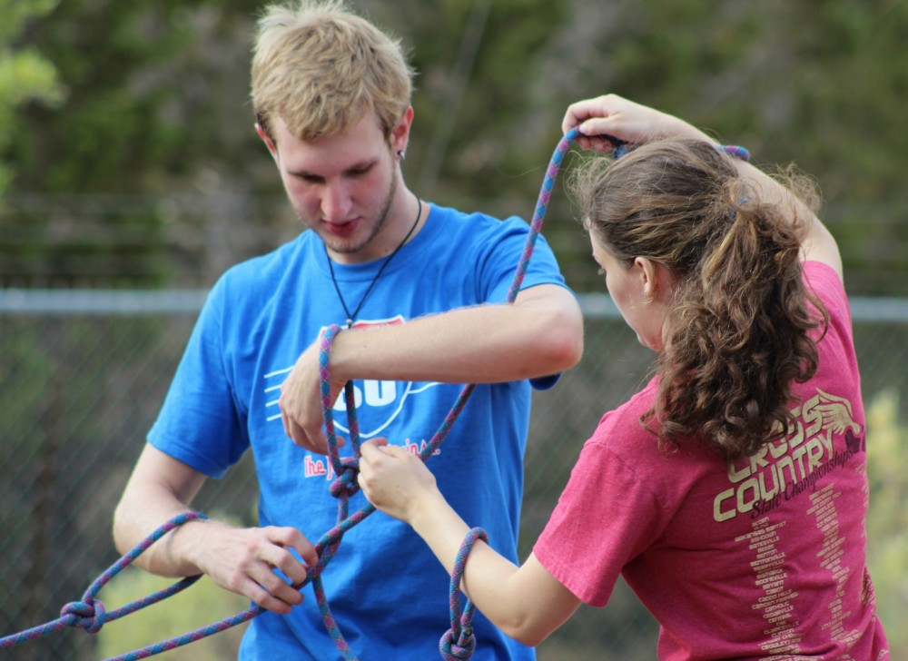 Nick Kellogg and Anna Zolten work on the rope challenge together (Photo by John Kotarski).