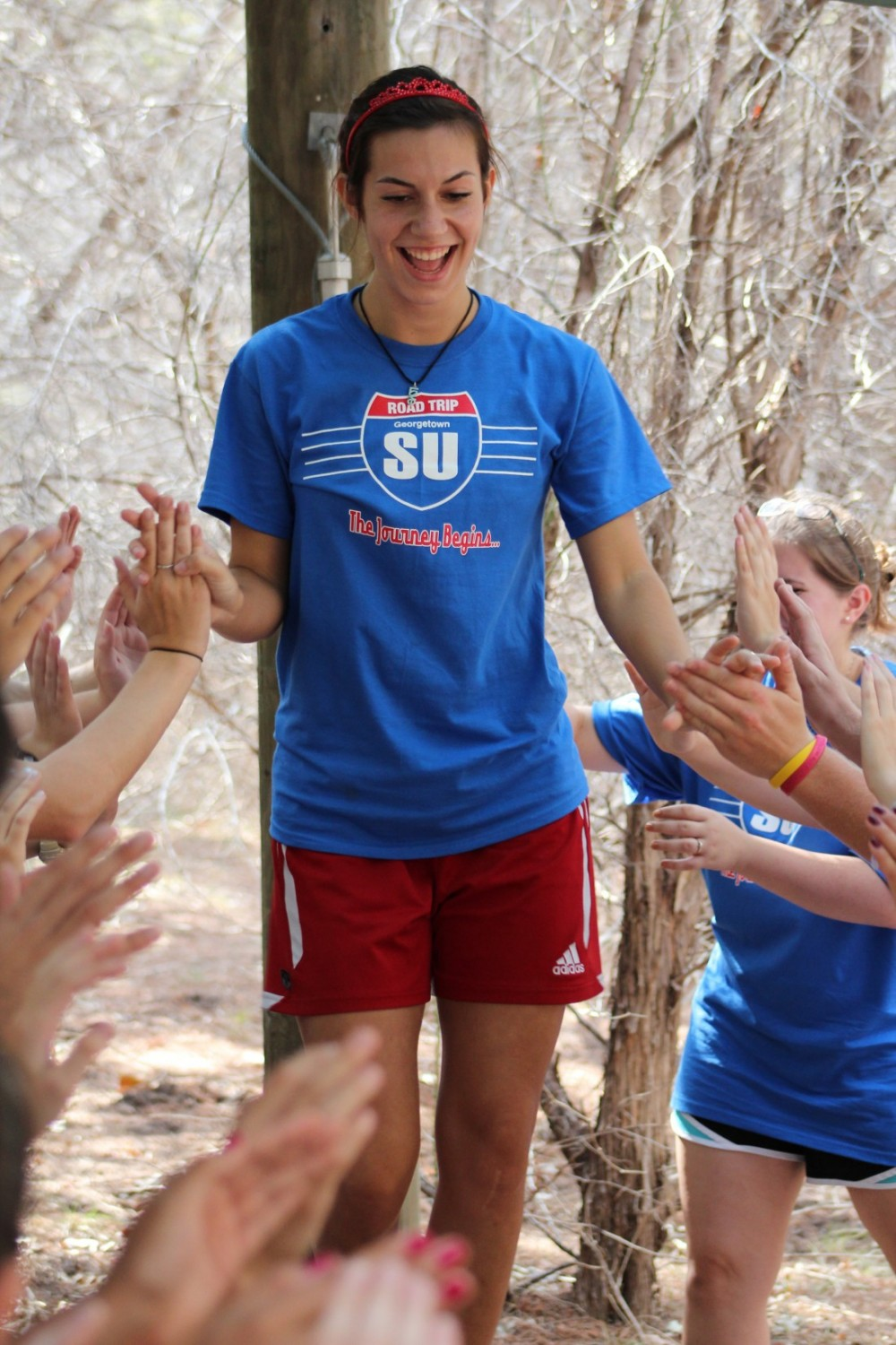 Katherine Freeman navigates the challenge in which students had to walk on a log that was suspended in the air (Photo by J...