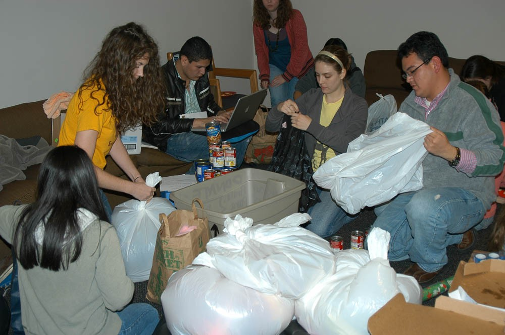 Students in Southwestern's Circle K International group package gifts to deliver to families in Matehuala, Mexico, over ho...