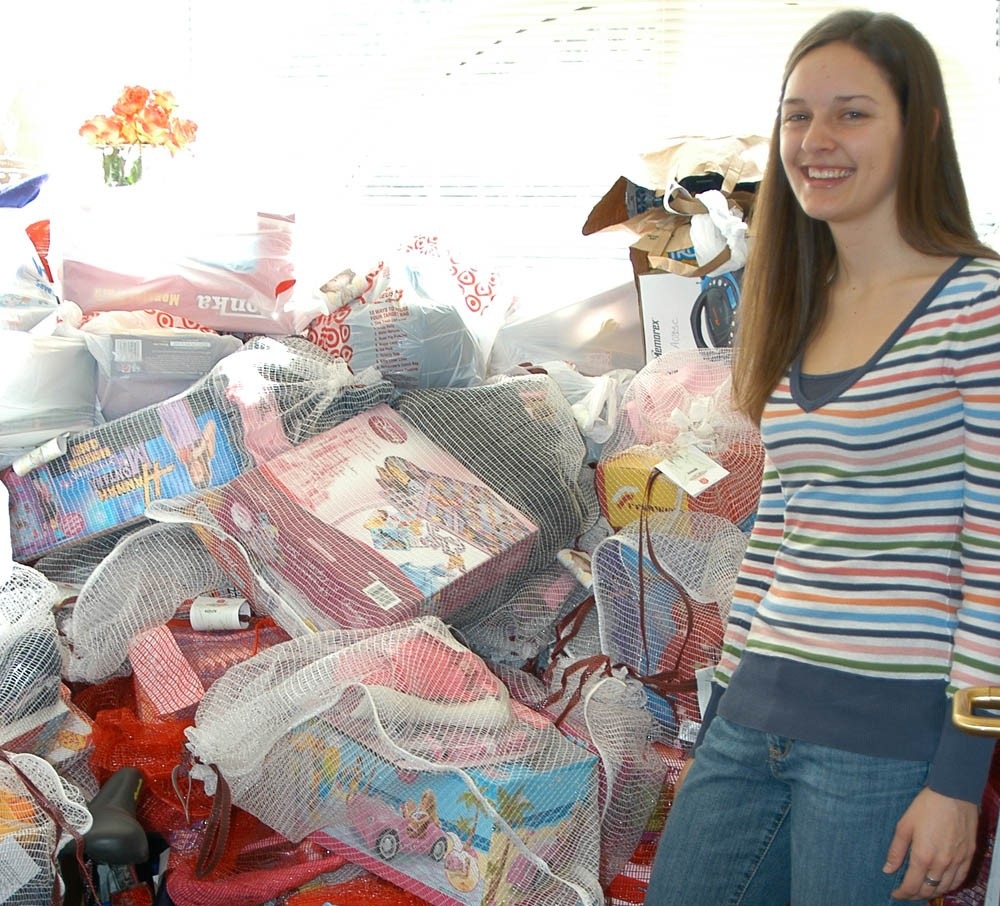 Mary Jansen, philanthropy chair for Sigma Phi Lambda, stands with toys her sorority collected for needy children in Centra...