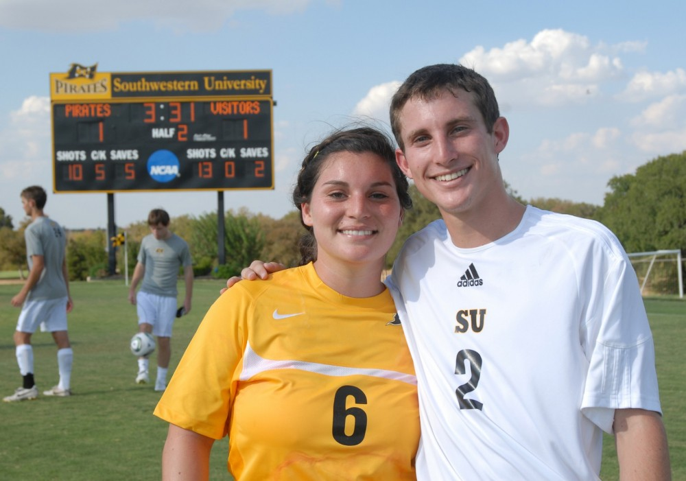 Lyndsey and Steven Resnik share a moment together in between their season opener games.