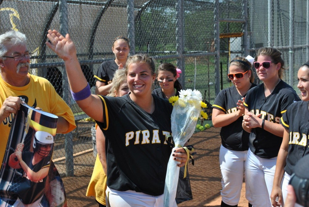 Kaitlyn Pavlicek smiles after being honored as one of the first graduating seniors on the softball team. (Photo by Karlis ...