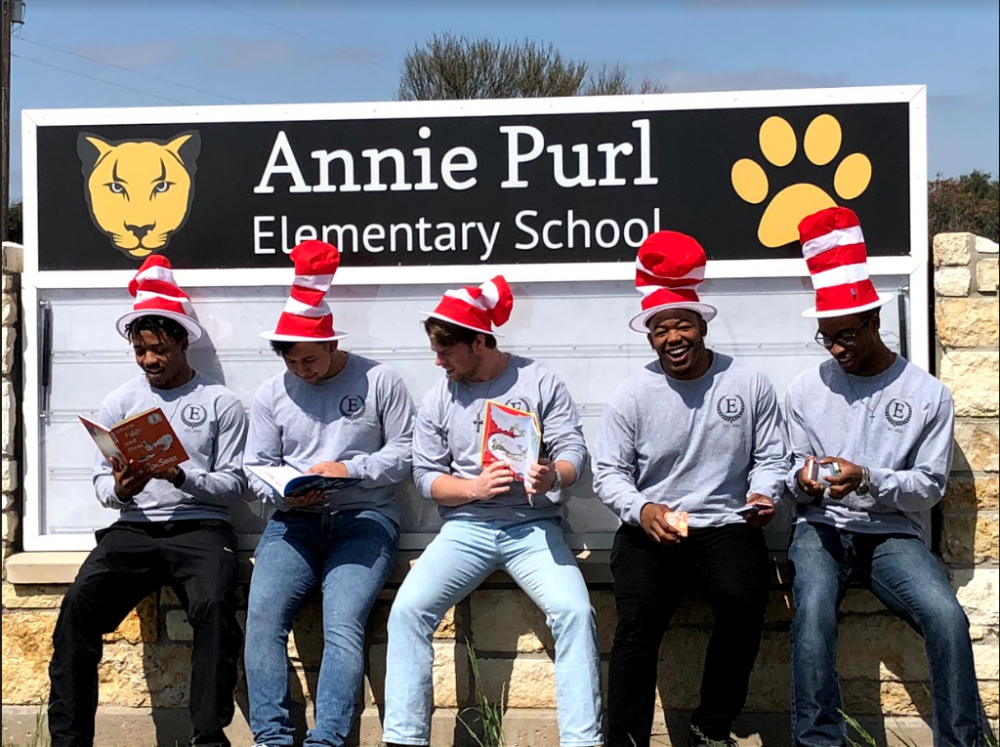 E.M.P.I.R.E. members volunteering at Annie Purl Elementary School.