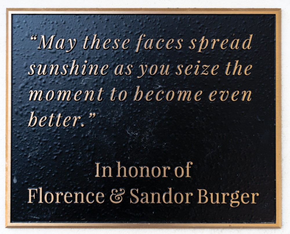 Commemorating one of Burger's many gifts to Southwestern, the plaque adorning the new public cloc...