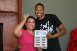 Josh Tates (right) accepts Intramural Official of the Year Award from SIRA Assistant Director Anna Castillo.