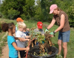 Children helping with composting.