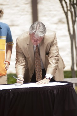 President Jake B. Schrum signs the Talloires Agreement.